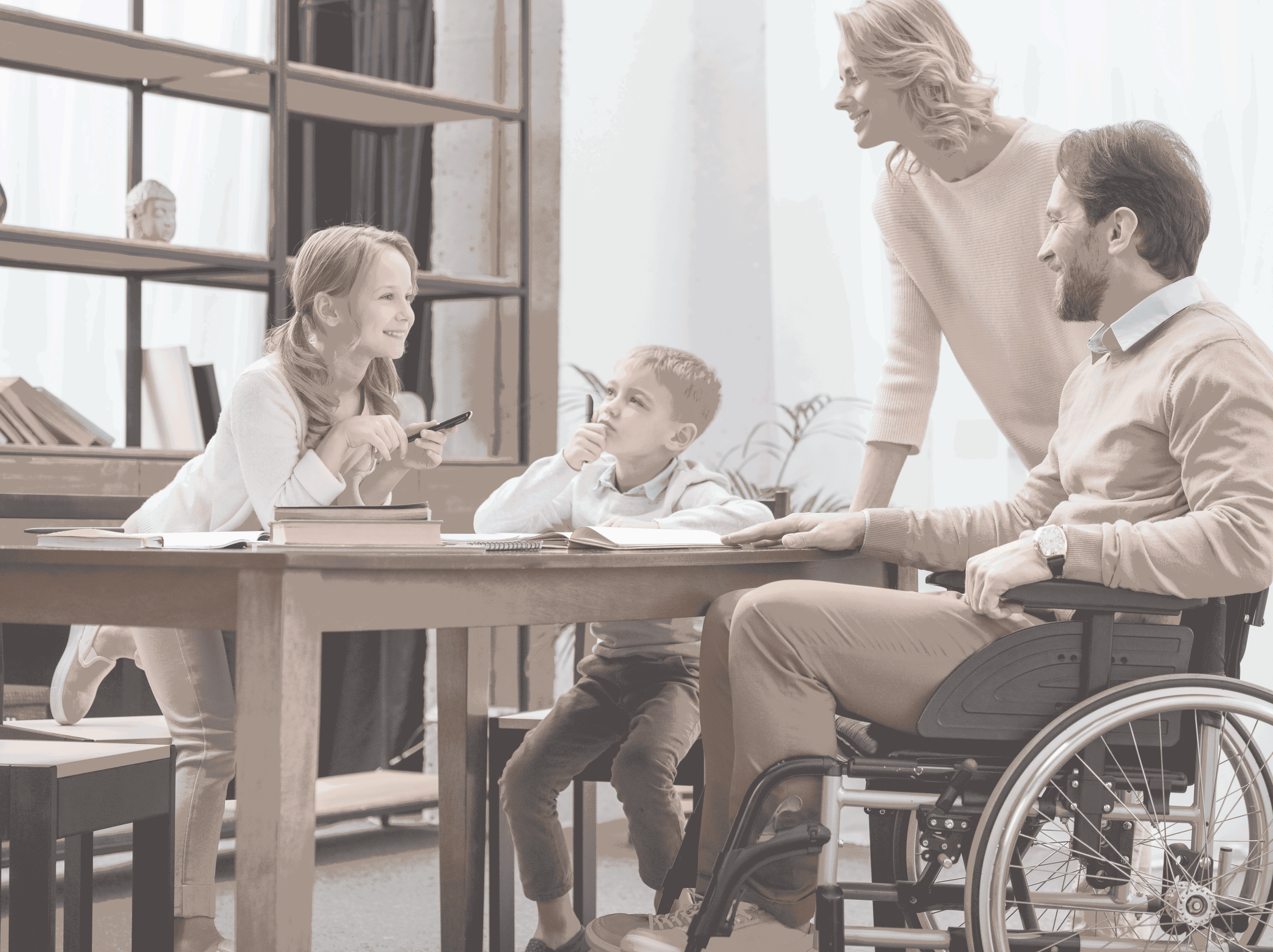 family around table with man in wheelchair
